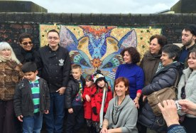Volunteers around the new mosaic